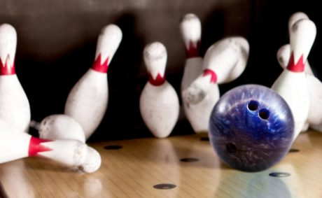 Bowling strike - ball hitting pins in the alley